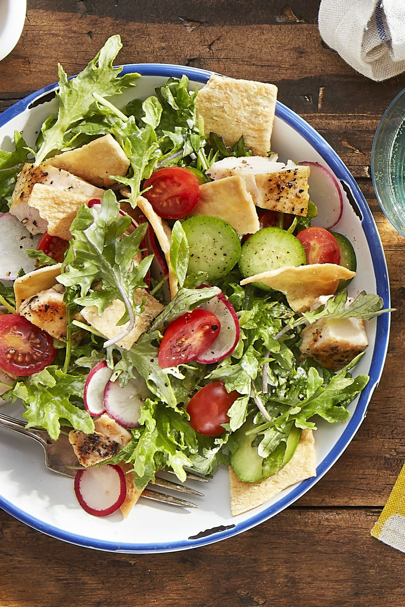 Salad with chicken, cale and pita